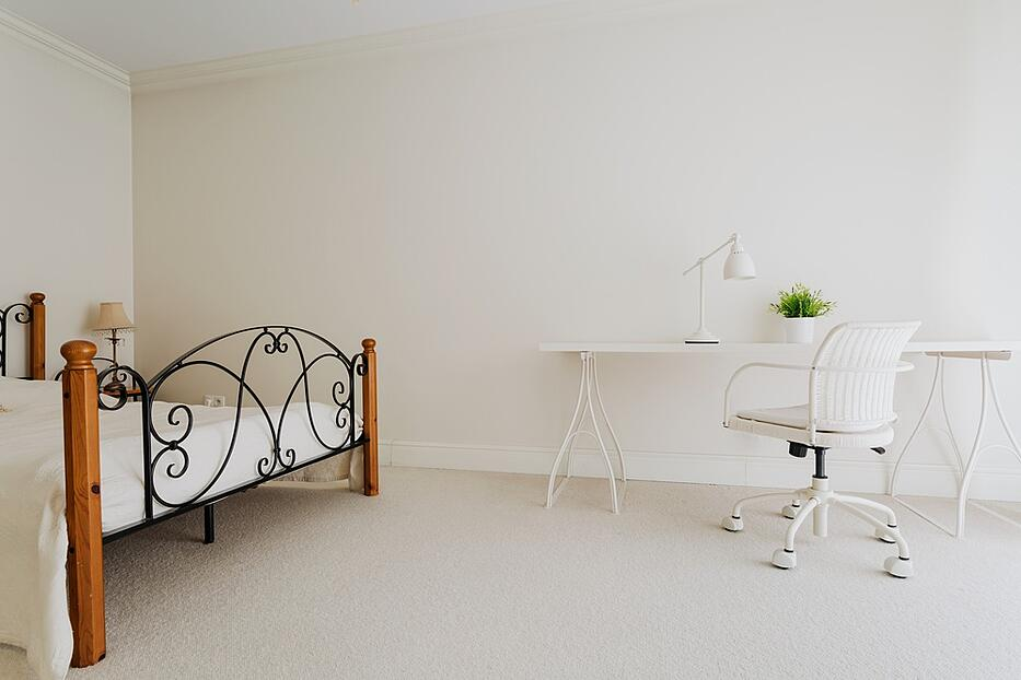 Picture of white bedroom in minimalist style.jpeg
